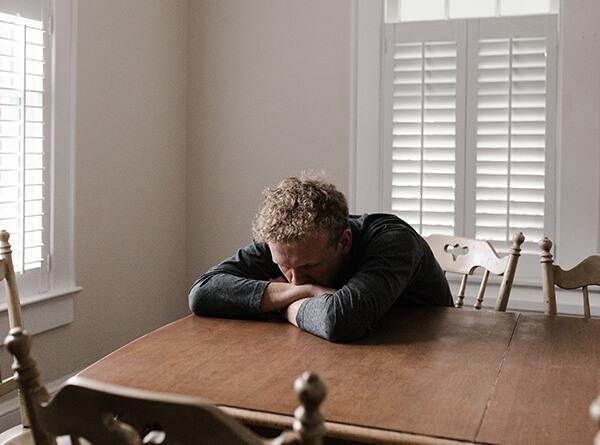 depressed guy at table